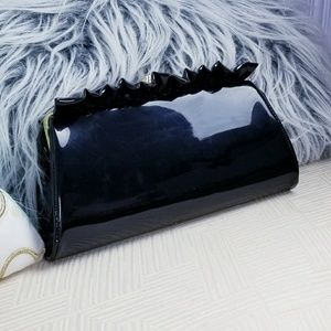 Patent leather ruffle clutch